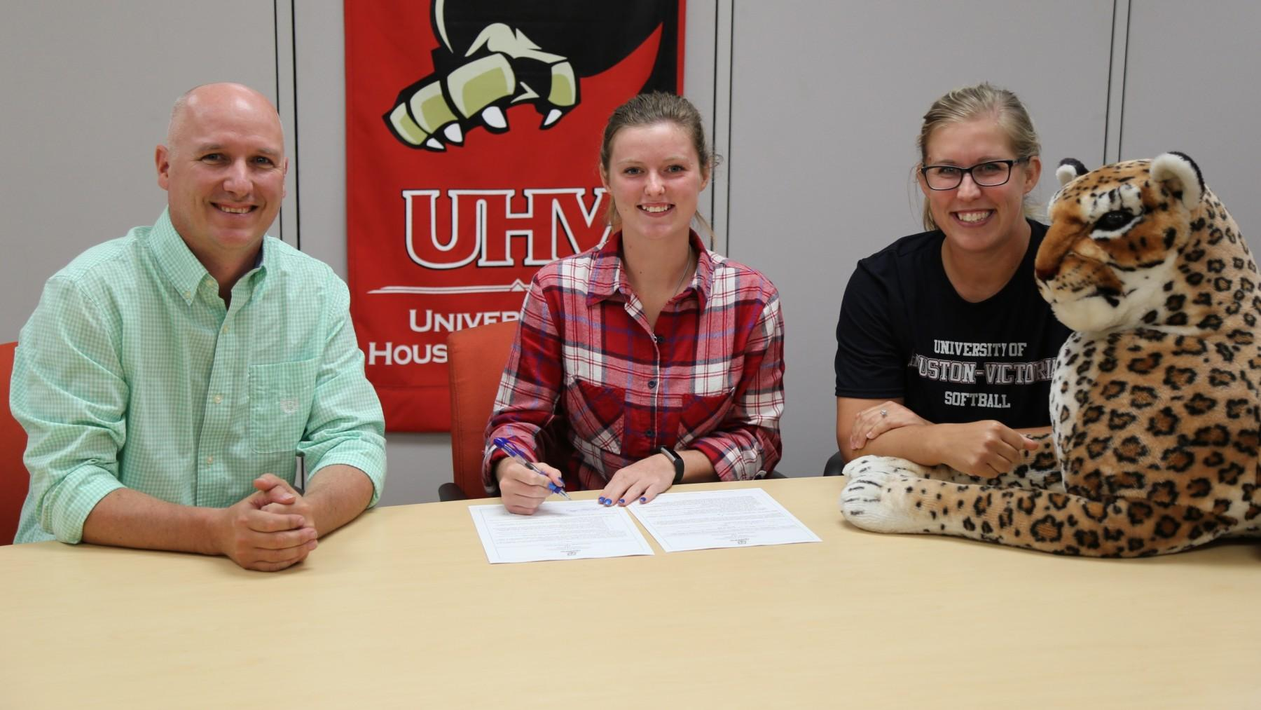 Edna's Chasity Richmond, center, signs a letter of intent to play softball for the UHV Jaguars.