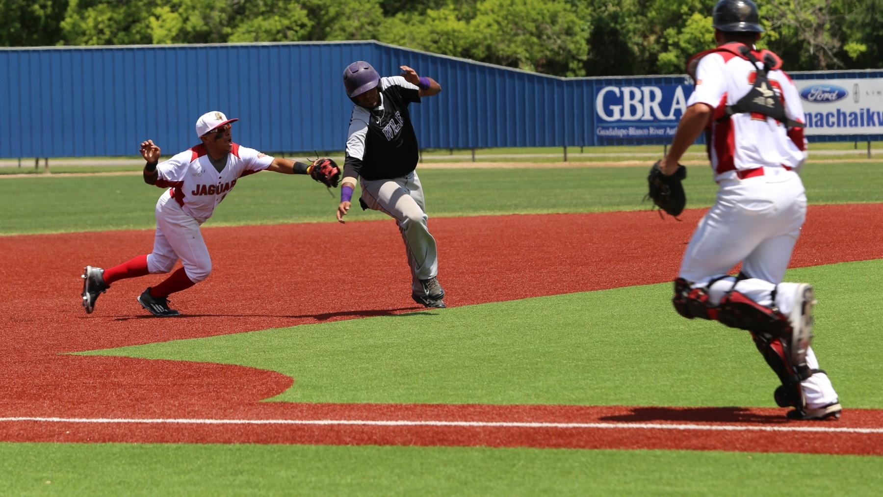 UHV's Jonathan Banuelos tags out a Wiley runner during a rundown Friday.