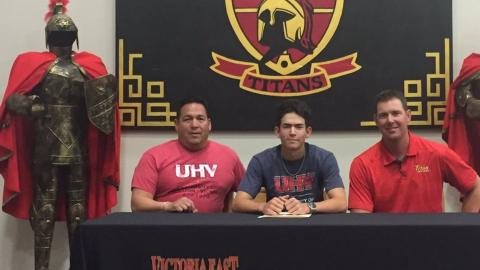 Victoria East's Alec Cruz, center, signed Wednesday to play baseball with the UHV Jaguars.