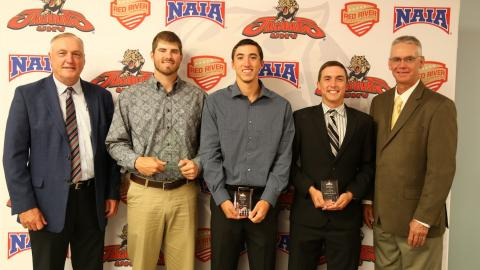 Head baseball coach Terry Puhl, Andrew Gross, Chase Tamez, Andrfew Richards and assistant coach Doug Heinold.