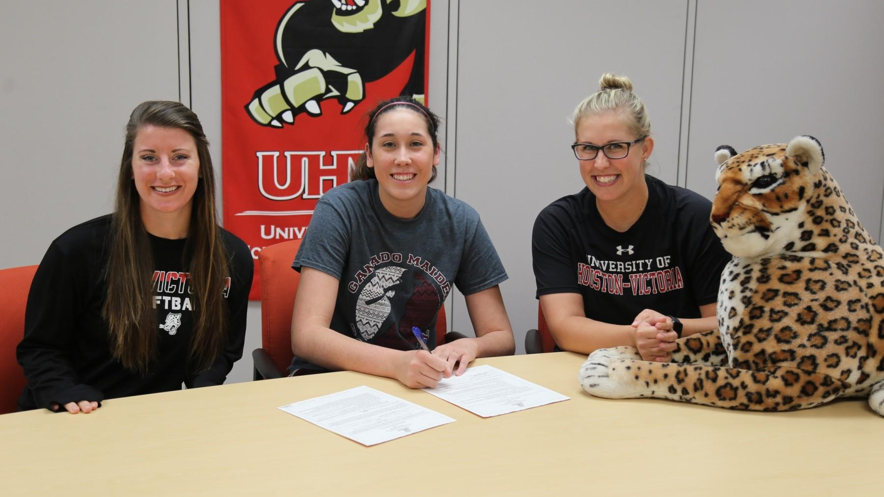 Ganado's Cheyenne Galindo, center, signs her letter of intent to play softball for UHV.