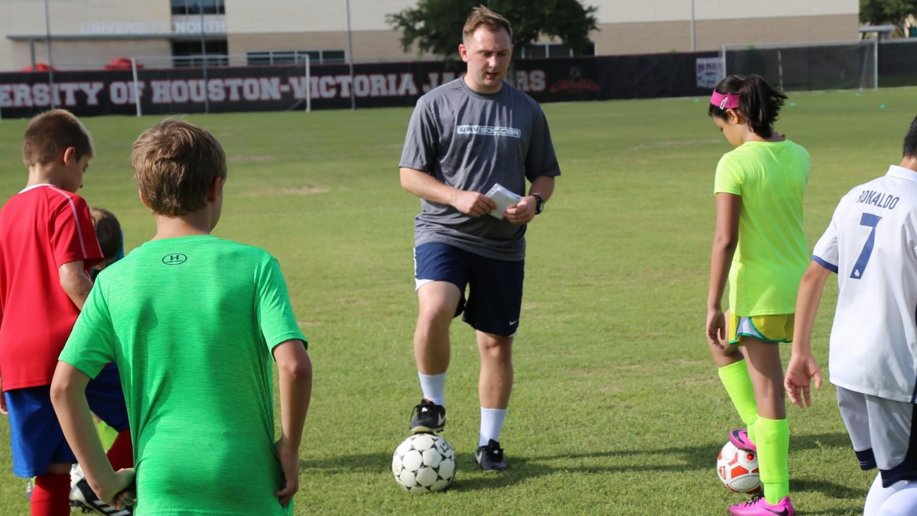 Brandon Misuraca, center, has been hired as an assistant coach for the UHV men's and women's soccer programs.